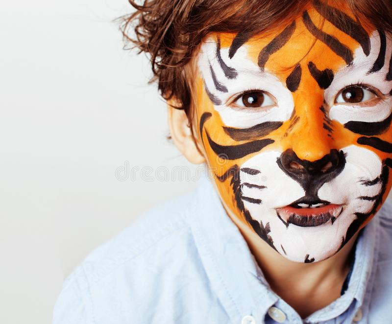 Little cute boy with faceart on birthday party close up, little. Cute orange tiger stock photos