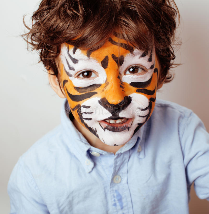 Little cute boy with faceart on birthday party close up, little cute tiger. Little cute boy with faceart on birthday party close up, little cute orange tiger royalty free stock photos
