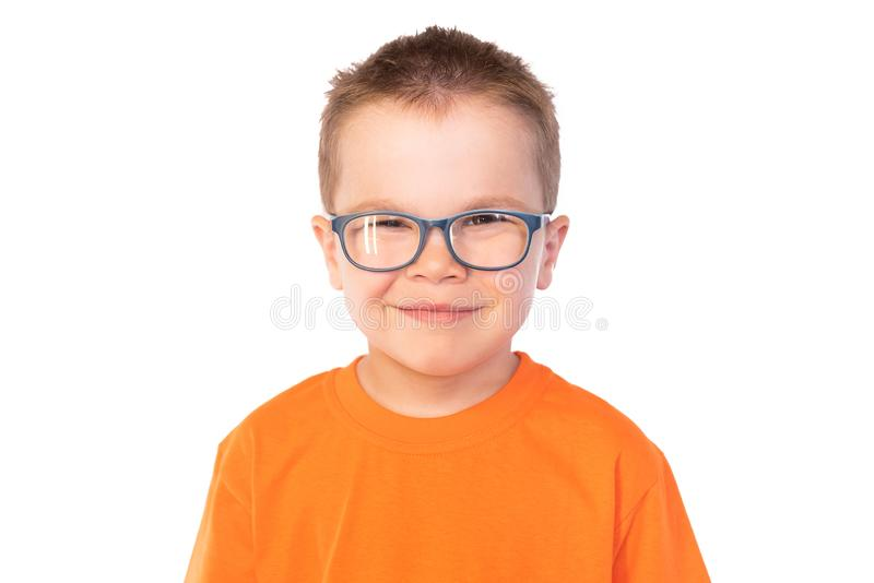 Little cute boy with glasses smiling isolated on white background stock photography