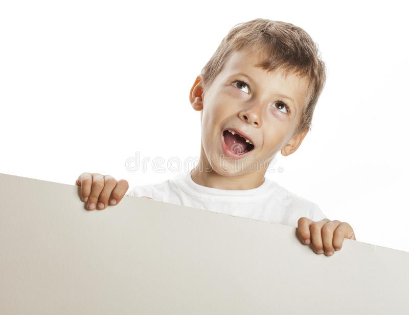 Little cute boy holding empty shit to copyspace stock photo