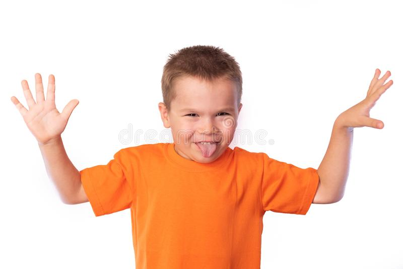 Little cute boy making funny faces, isolated on white background stock photography