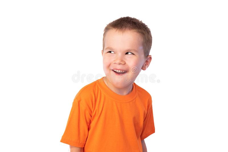 Little cute boy making funny faces, isolated on white background stock image