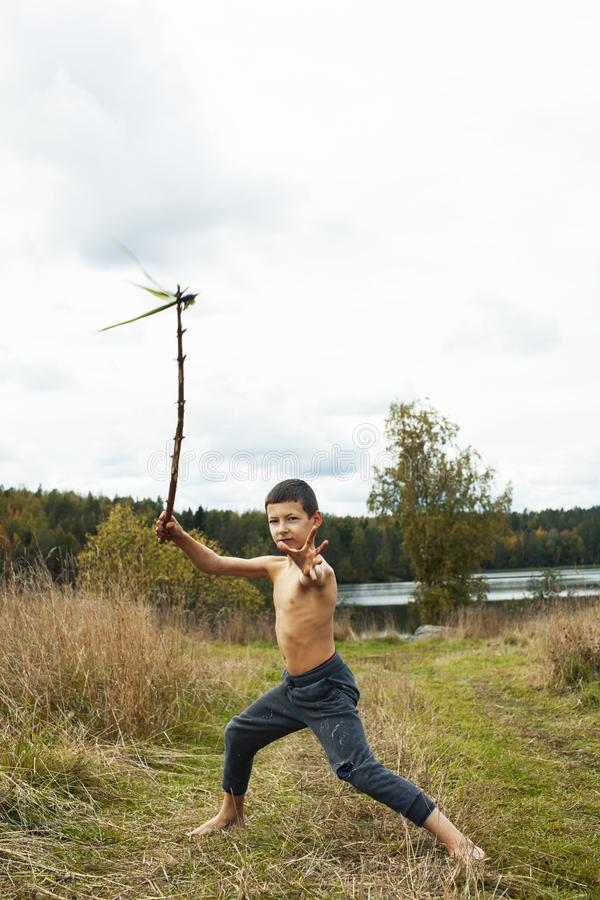 Little cute boy playing outside like wild indian chief, lifestyle real people concept royalty free stock image