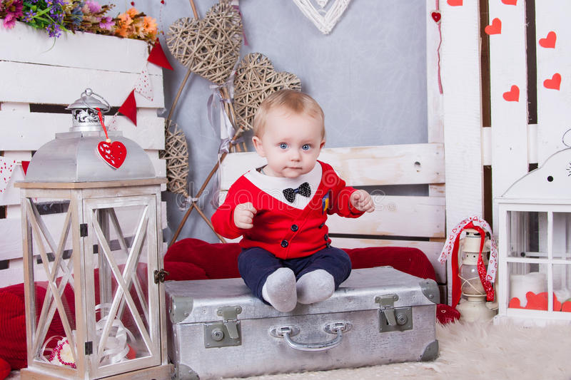 Little cute boy in red jacket with tie royalty free stock images
