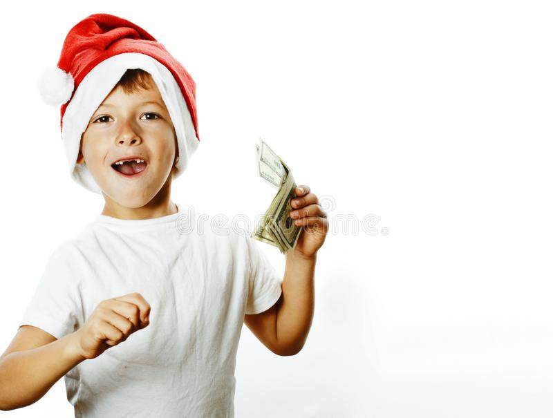 Little cute boy in santas red hat isolated with cash american dollars thumbs up happy kid holiday celebration. Closeup royalty free stock photography