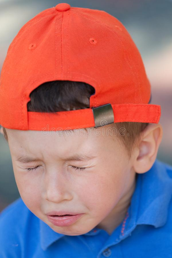 Little cute boy sneezing. little boy with the flu or allergy stock photography