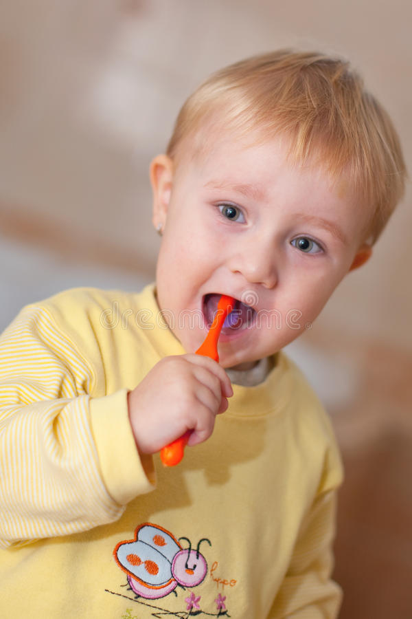 Download Little Cute Child Brushing Her Teeth Stock Photo - Image of hygiene, maintenance: 11950386