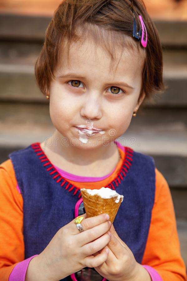 Little cute child girl eating ice cream. Food, dessert, happy childhood, carelessness concept.  royalty free stock images