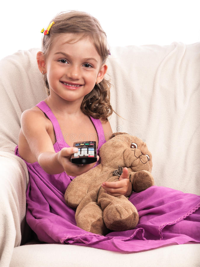 Little cute child with TV remote control