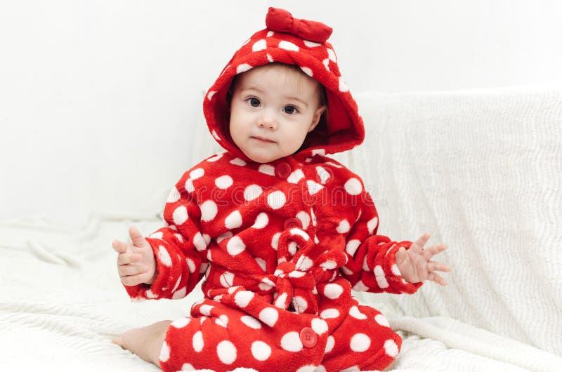 Little cute girl in a bathrobe stock image