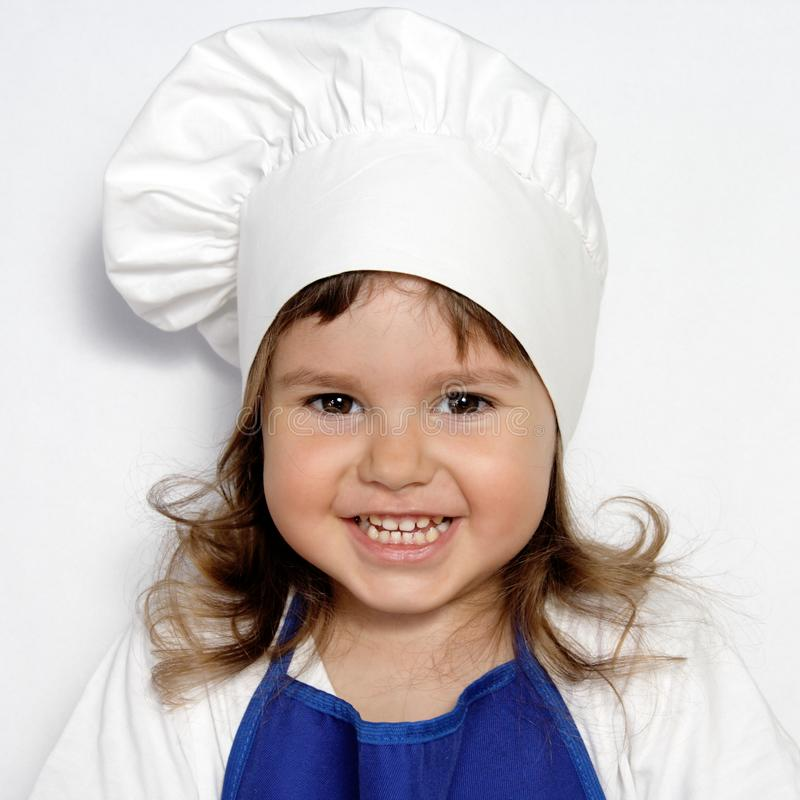 Download Little Cute Girl In Cook's Cap Portrait Stock Photo - Image of child, white: 19639636