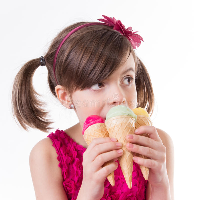 Little cute girl with ice cream. Over white background royalty free stock image