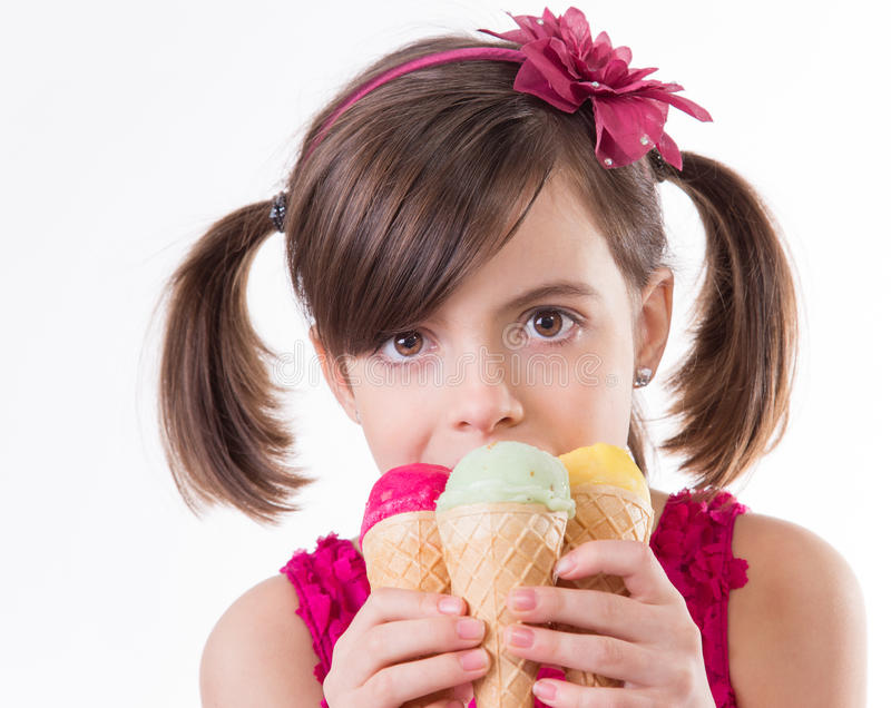 Little cute girl with ice cream. Over white background stock images