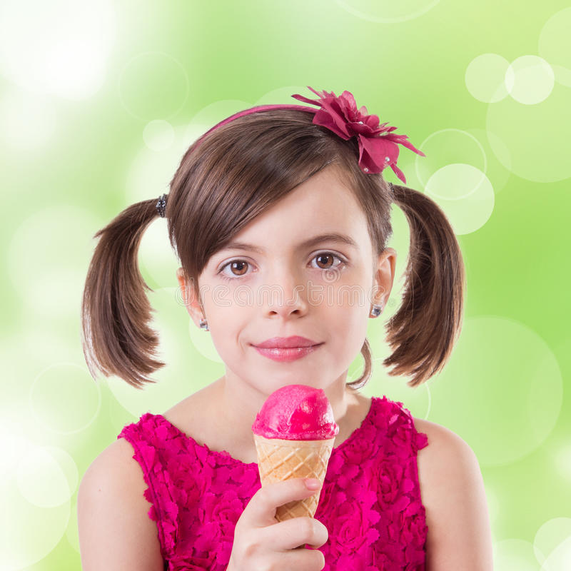 Little cute girl with ice cream. Over white background stock photography