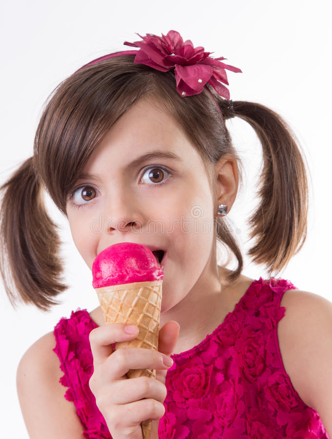 Little cute girl with ice cream. Over white background stock photos