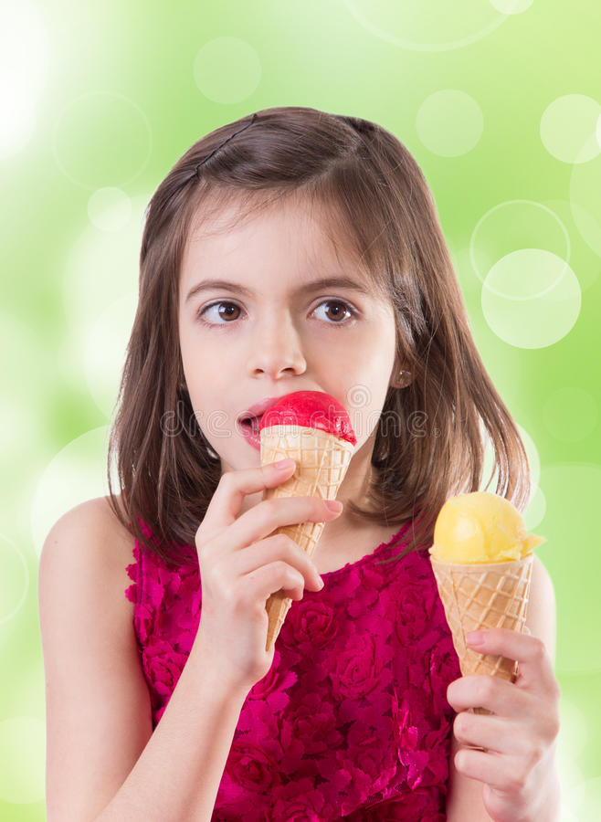Little cute girl with ice cream. Over white background royalty free stock photography