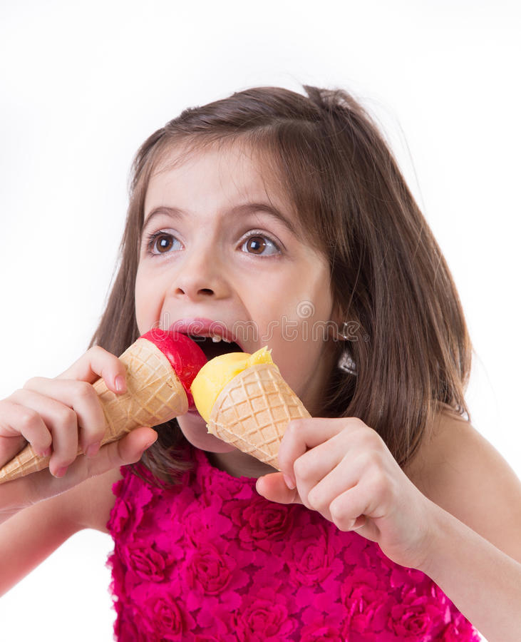 Little cute girl with ice cream. Over white background royalty free stock images