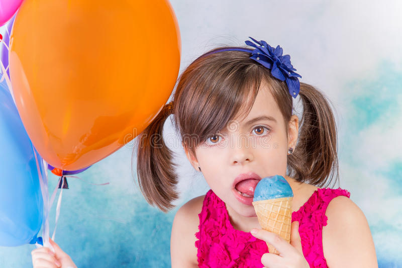 Little cute girl with ice cream. Over white background royalty free stock photos