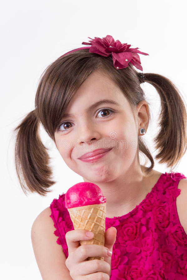 Little cute girl with ice cream over white. Background royalty free stock photos