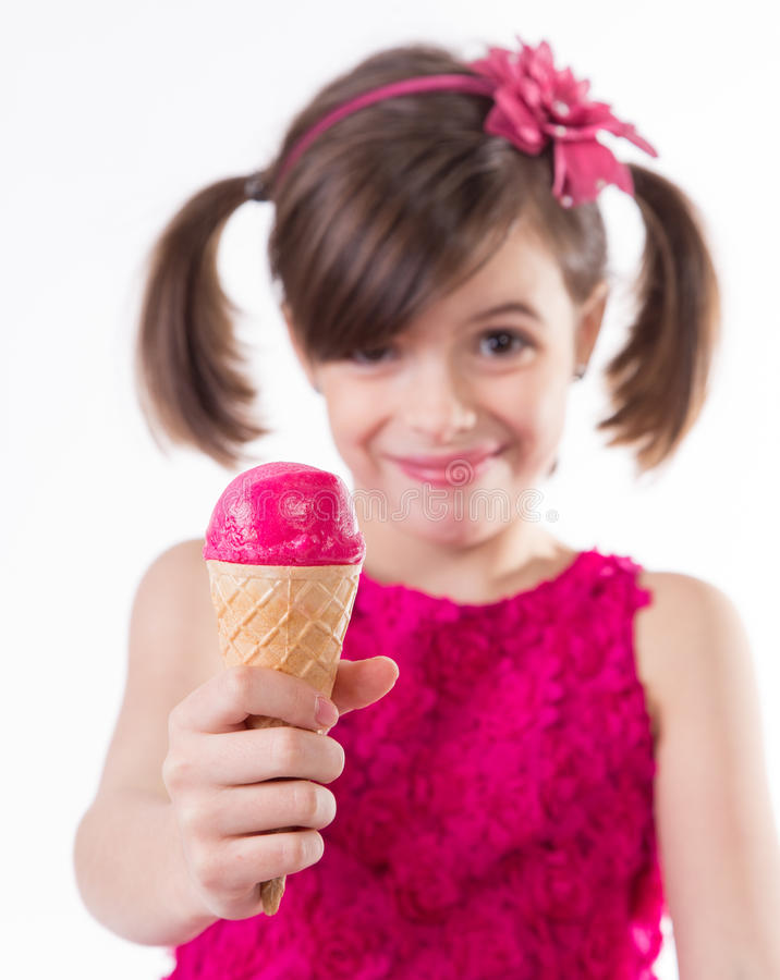 Little cute girl with ice cream over white. Background stock image