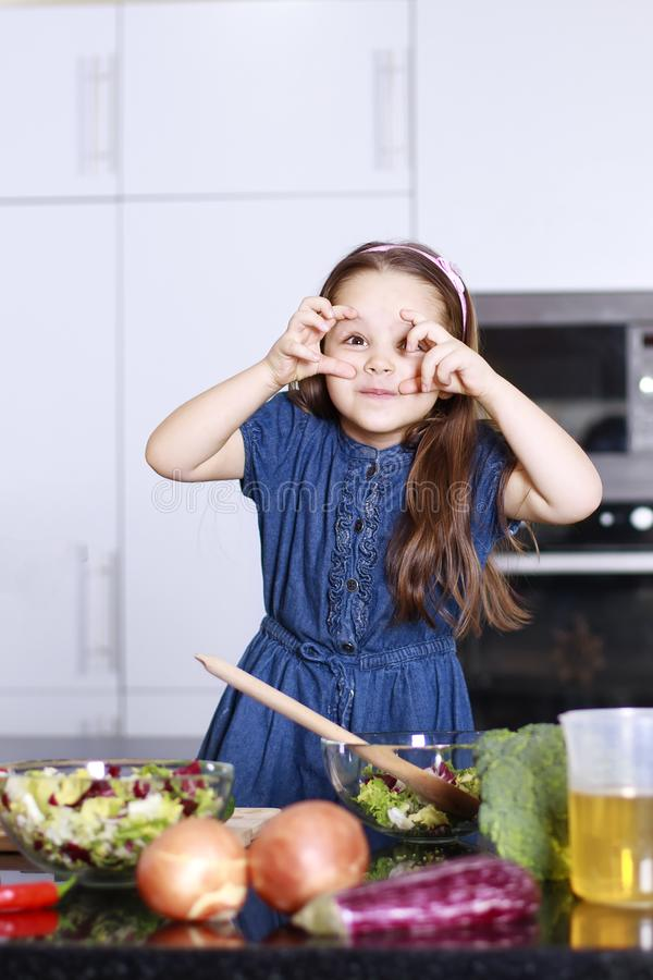 Little cute girl indulges in kitchen, Family concept royalty free stock images