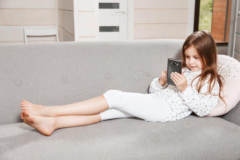 Little Cute Girl Using Mobile Phone stock photos
