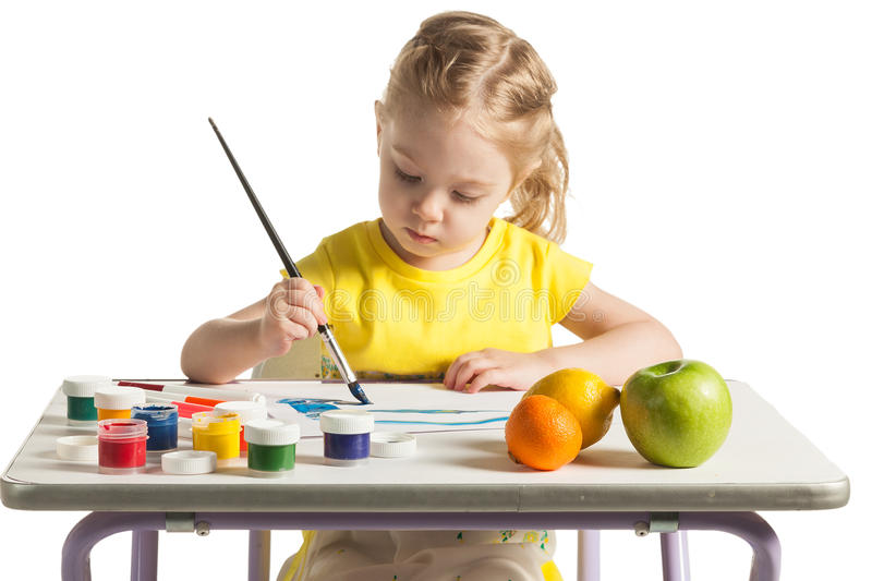 Little cute girl learning to painting, on white background stock photo