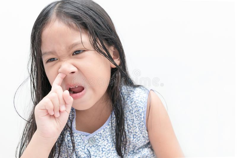 Little cute girl pick her nose, Health care stock photo