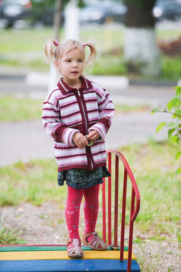 Download Little Cute Girl On Playground Stock Photo - Image: 20196628