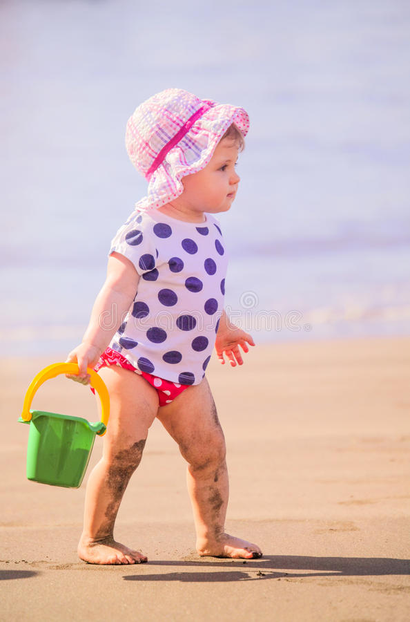Little cute girl playing in the sand royalty free stock photo