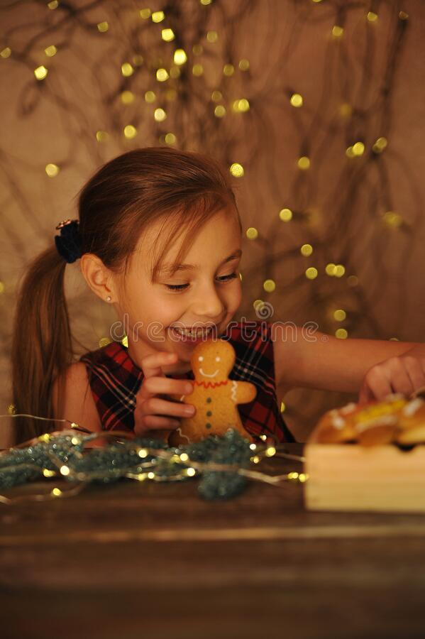 Free Little Cute Girl Plays With Gingerbread Man. Stock Photography - 205341252