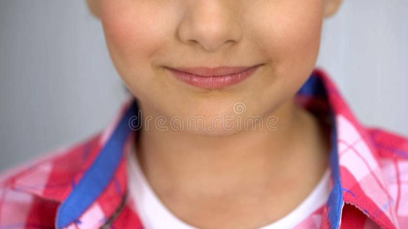 Little cute girl smiling to camera, happy childhood concept, tender skin. Stock photo stock images