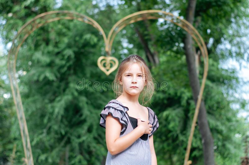 Little cute girl street city lifestyle shooting, summer, smiling at camera royalty free stock photos