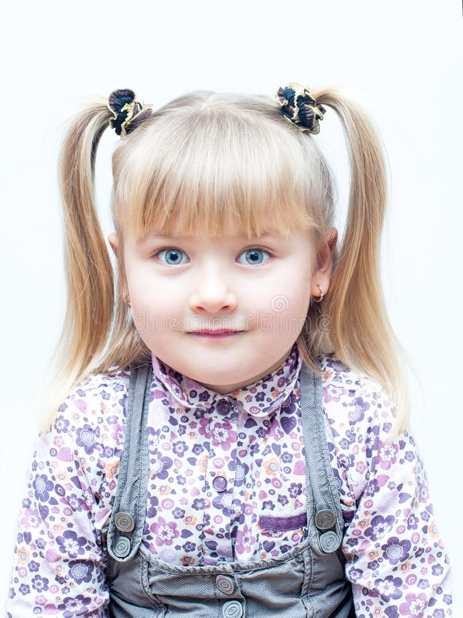 Little cute girl with tails royalty free stock photography