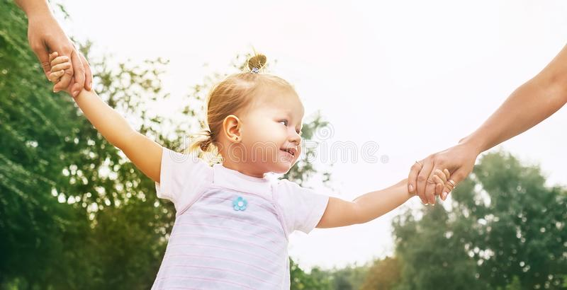 Little Cute girl take hands with her relatives people stock image