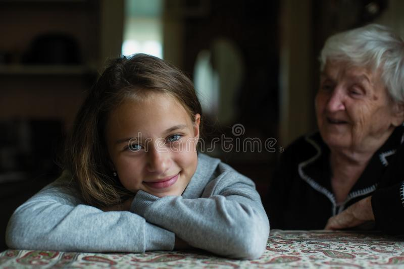 A little cute girl visiting her grandmother. Family. A little cute girl visiting her grandmother royalty free stock photo