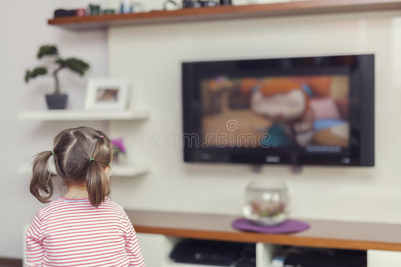 girl watching television  Little Cute Girl Watching Television Stock Image - Image of flat ...