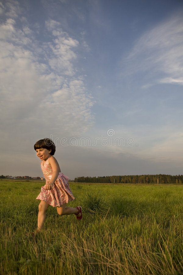 Download Little Cute Happy Girl Running On Meadow Stock Photo - Image: 8641824