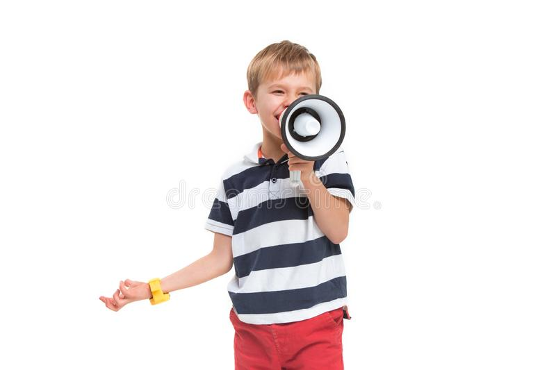 Little cute kid baby boy holding in hand and speaking in electronic gray megaphone stock images