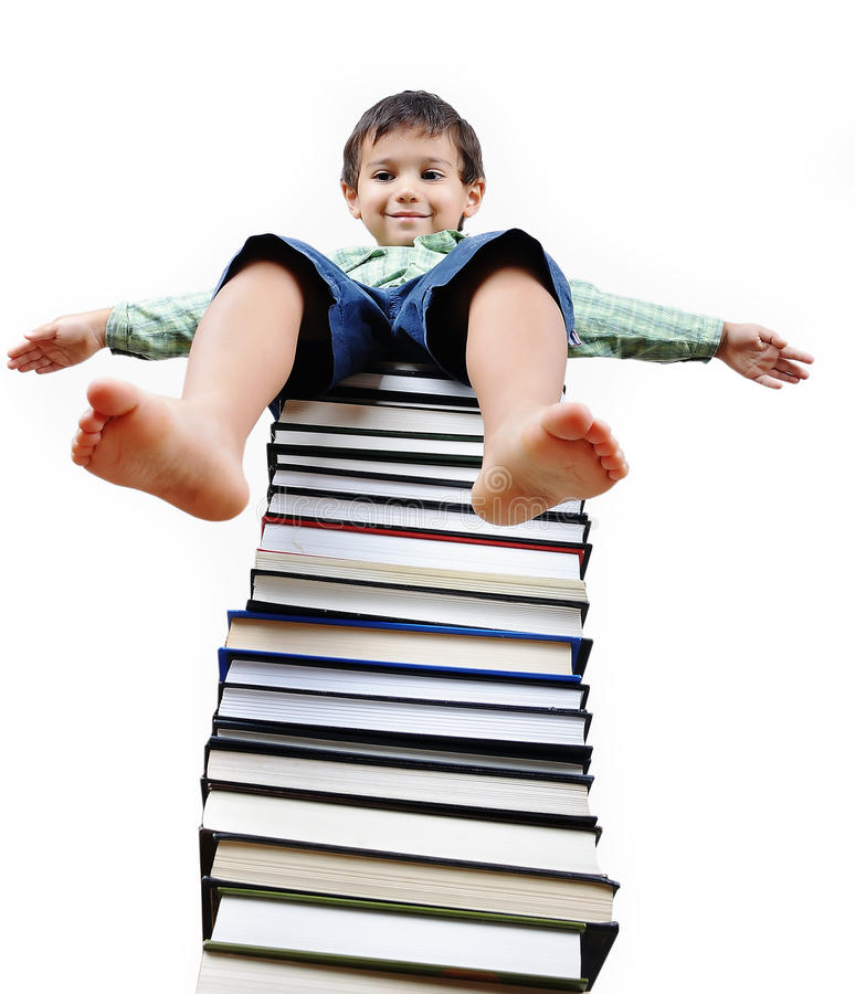 A little cute kid and books. A little cute kid and large number of books stock photography