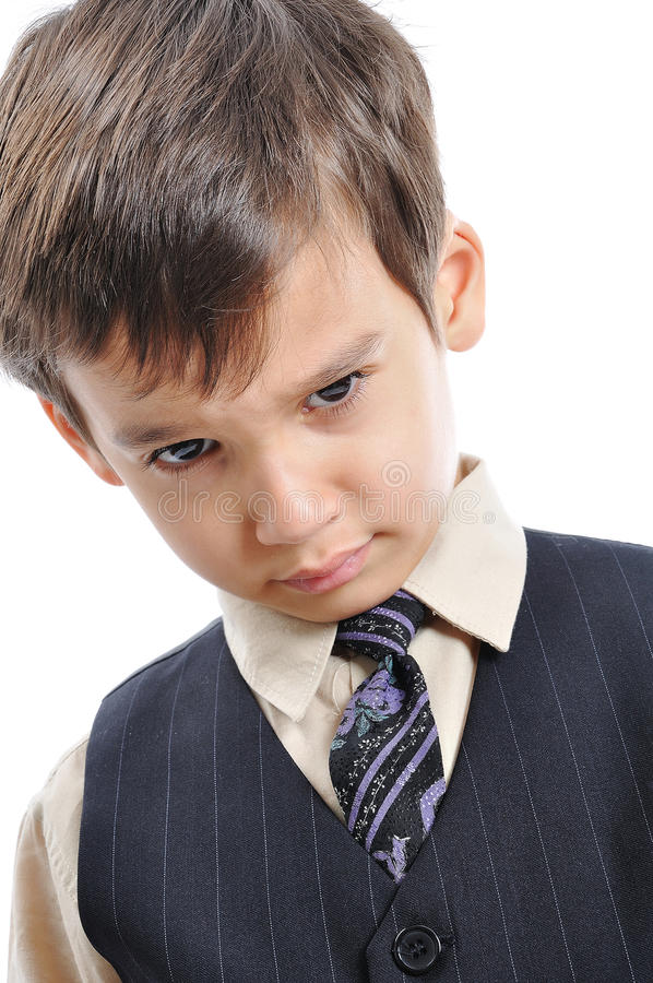 A little cute kid in business suit. Isolated royalty free stock photography