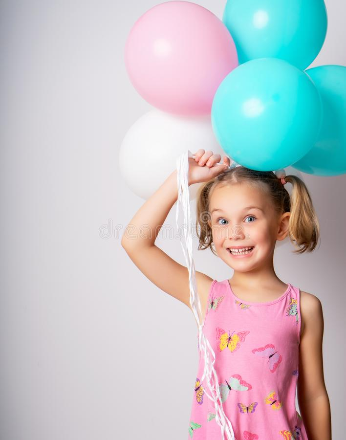 Beautiful little girl and bright balloons stock images