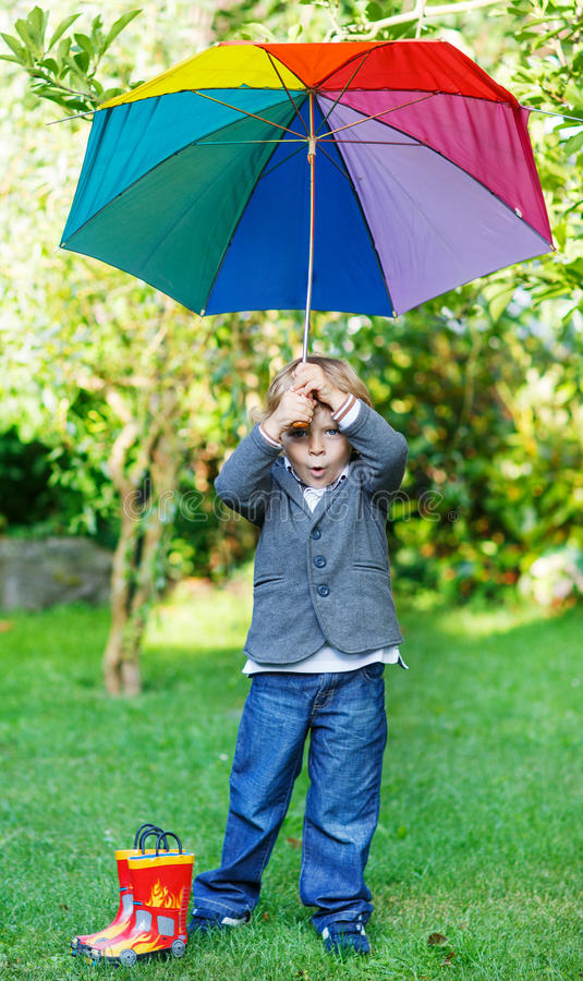 Free Little Cute Toddler Boy With Colorful Umbrella And Boots, Outdoors Stock Image - 37434191