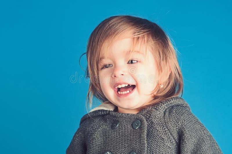 Little cutie. childhood and happiness. autumn and spring kid fashion. having fun. little girl child smiling. small happy royalty free stock images