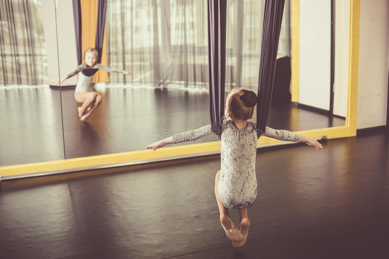 Little dancer in a aerial yoga hammock stock image