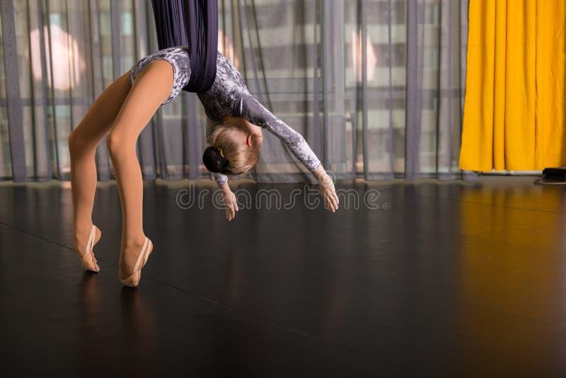 Little dancer in a aerial yoga hammock stock photos