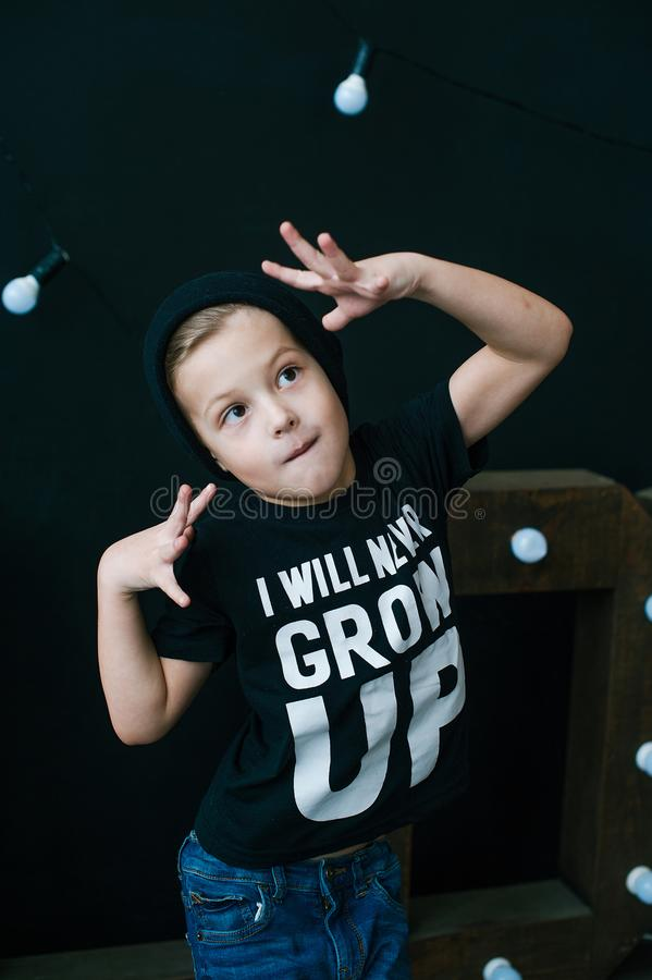 Little dancer. Fashionable little boy. Hip-Hop style. Young rapper. Funny child in cap. royalty free stock photos