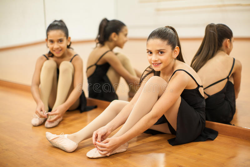 Little dancers getting ready for class royalty free stock photo