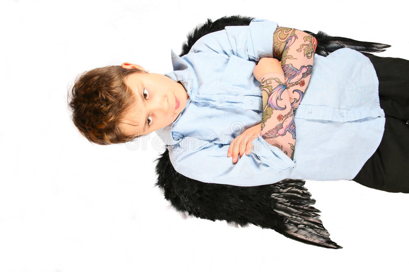 Little Dark Angel. Little boy dressed up as a dark angel with attitude. Isolated against a white background stock images