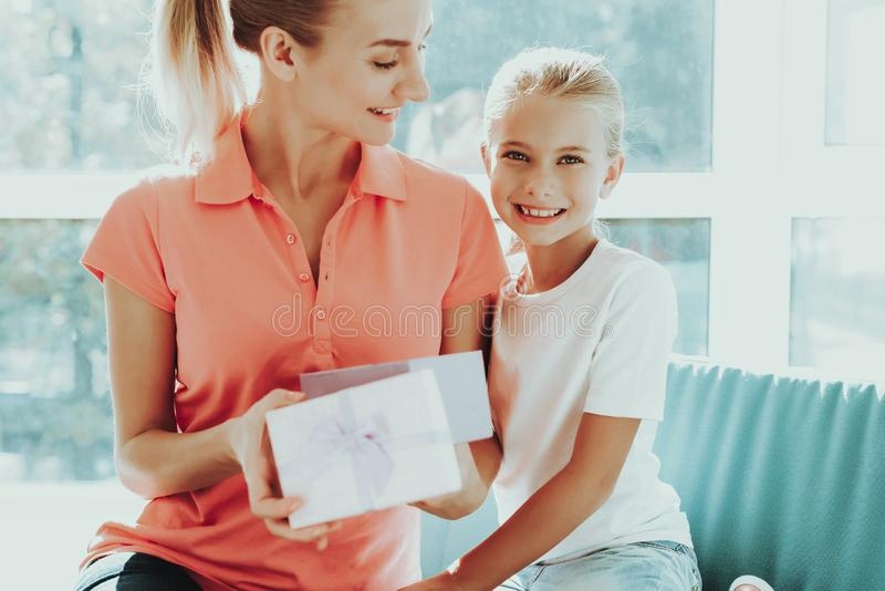 Little Daughter Is Giving A Present Box To Mum. Family Relationship Concept. Active Holiday. Beautiful Moment. Postcard To Parent. Happy Childhood. Celebrating royalty free stock photos